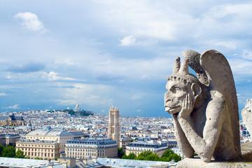Gargoyle of Notre Dame looks to Paris