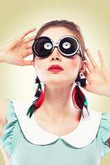 Retro girl in round sunglasses