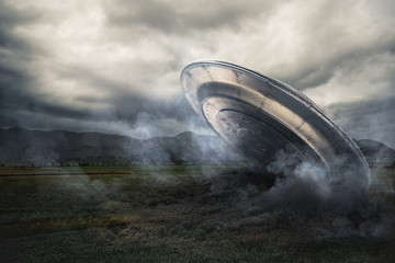 Photo sur Aluminium UFO UFO crashing on a crop field