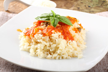Rice with tomato sauce and basil