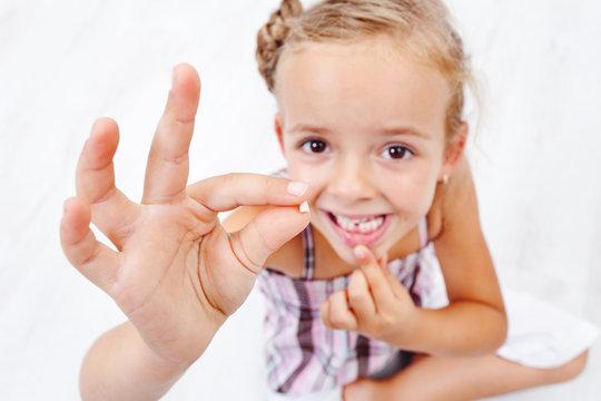 Little girl first milk-tooth fallen out