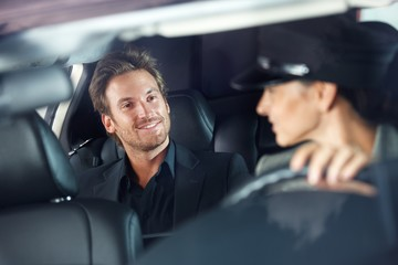 Handsome man in luxury car smiling