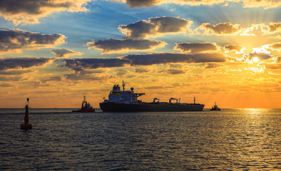 Solar Convoy - Tanker at sunset putting out to sea.