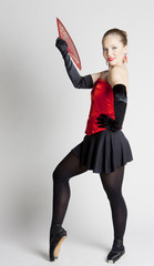 ballet dancer holding a fan