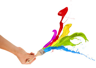 Colored paints splashing out of brush