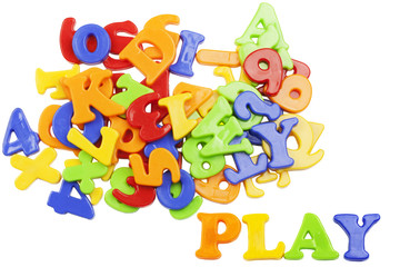 PLAY lettering near plastic alphabet letters