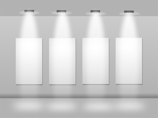 frames on white wall in art gallery with lights