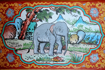 Elephant painting on stone wall.