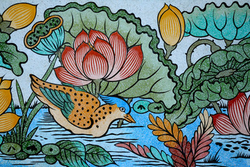 Bird and Lotus painting on stone wall.