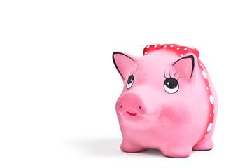Side shot of the cute piggy ceramics moneybox on white backgroun