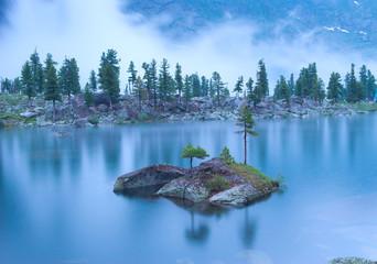Night landscape of mountain lake under the rain