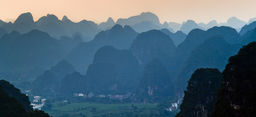 Guilin village at sunset from Moon Hill. Yangshuo, China