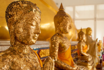 statue of buddha with gold leaf