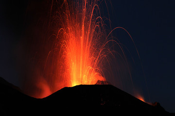 Fire at night. Volcano erupting Wall mural
