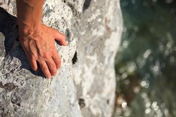 Female hand on rock