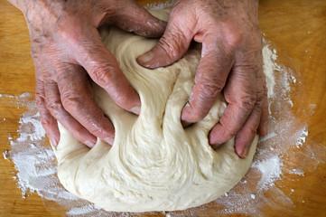senior woman make dough
