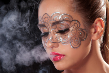 Young woman in a veil of cigarette