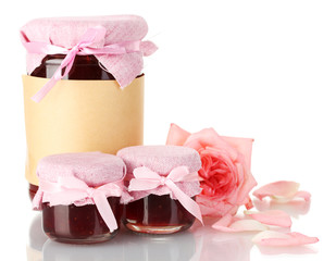 jars with rose jam and flower isolated on white
