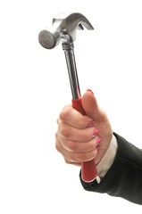 Hammer in hand of businesswoman isolated on white background