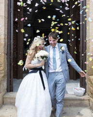Confetti being thrown over the Bride and Groom