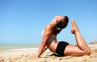Yoga practice at the sea beach