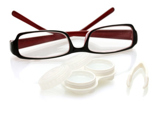 glasses, contact lenses in containers and tweezers, isolated