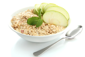tasty oatmeal with apple, isolated on white