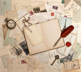 empty open book, old accessories and post cards