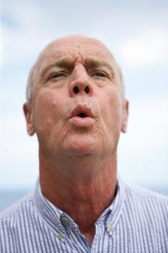 Expressive man whistling