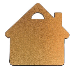golden metallic house shaped object on white background
