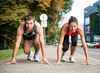 Rivalry - young couple competing in running