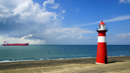 Wall Mural - Lighthouse on the blue sky background. Westkapelle