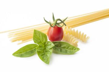 spaghetti with tomato cherry and basil on white background