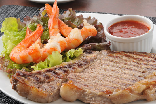 Grilled rib steak close up with shrimp
