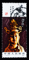 A stamp printed in China shows the ancient buddha statue