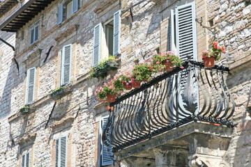 flowered balcony in a terrace of an ancient medieval palace