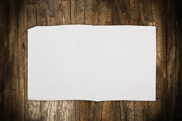 Wrinkled blank paper on a wooden background