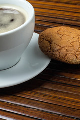 cup of coffee with almond cookie