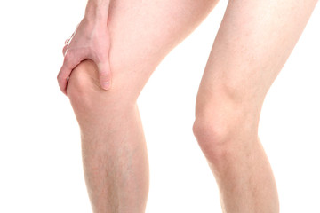man holding sore knee, isolated on white