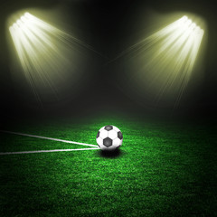 Soccer ball on the green field with lightnings