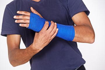 man with blue arm bandage