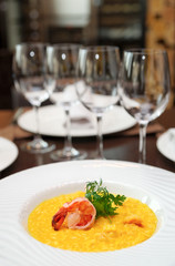 Risotto with shrimp on arranged table
