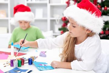Kids making christmas greetings