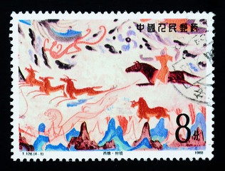 A stamp printed in China shows Chinese ancient wall painting art
