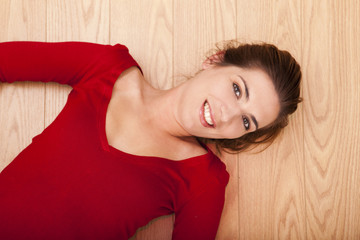 Woman lying on the floor and smiling