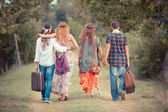 Hippie Group Walking on a Countryside Road