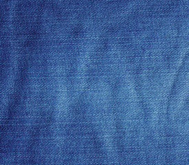 Crumpled blue jeans fabric texture