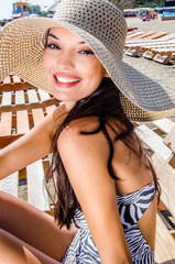 Beautiful girl with hat laughing