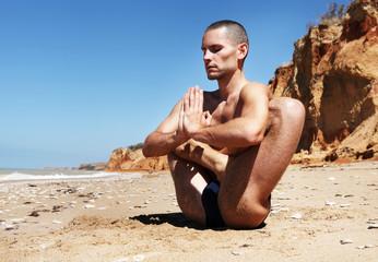 Sitting yogi at the deserted beach