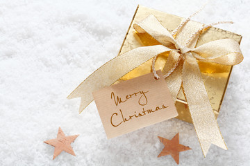 Gold gift with Merry Christmas tag